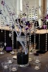 manzanita, hanging crystals, and votive candle centerpiece