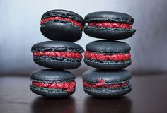 Macaroons: Black with red cream filling.