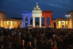 In the aftermath of the attacks, the Brandenburg Gate in Berlin and buildings around the world lit up with the French colors in a show of solidarity and support. People Around The World, Around The Worlds, Le Bataclan, Paris Terror Attack, Eagles Of Death Metal, French Colors, Brandenburg Gate, Turn Blue, Disneyland Paris