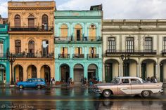 Paseo de Marti and its arraw of sherbet colored buildings and vintage cars, Cuba