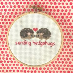 "Cross Stitch Embroidery Hedgehog Cross Stitch - This 4 inch wooden hoop cross stitch is the perfect way to show your love. Skip the card and send our ""Sending Hedgehugs"" cross stitch instead. Perfect for your desk or a girls nursery! Hedgehog Cross Stitch, Geek Cross Stitch, Cross Stitch Needles, Simple Cross Stitch, Cross Stitch Animals, Counted Cross Stitch Patterns, Cross Stitch Designs, Cross Stitch Embroidery, Embroidery Patterns"