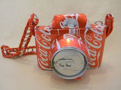Caneras!! Pretend Cameras made from recycled pop cans.... there's even a pop out birdie, so fun! Available at ArtistsWalk in Burlington, ON