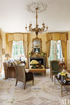 A Louis XVI chandelier crowns the living room at a 1920s San Francisco–area home renovated by Douglas Durkin. The space is appointed with a Durkin-designed ottoman by C. Mariani Antiques and a custom-made rug by Beauvais Carpets; a Brunschwig & Fils fabric curtains the windows.