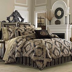 The J. Queen New York Onyx Comforter Set has a detailed woven damask design in onyx on a polished black background for a truly luxurious and opulent look.