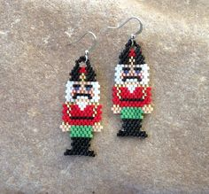 These earrings are beautiful in contrasting colors. They are light weight. Made out of glass Delica beads with silver french hooks. They are 2 1/2 long with french hooks, and 1 wide. The stitch is Peyote Stitch. They would make a great gift or for yourself. Thank you for stopping by, please come back soon. Have a great day Beaded Crafts, Beaded Ornaments, Etsy Earrings, Perler Earrings, Beaded Earrings, Beaded Jewelry Patterns, Beading Patterns, Pearler Bead Patterns, Cross Stitch Christmas Ornaments