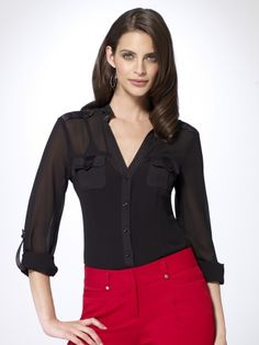 Sheer long sleeve button front blouse with breast flap pockets. Rolled sleeves with tab detail. Shoulder epaulettes. Contrast trim. 100% polyesterTrim: 95% silk, 5% spandeximportDry clean or machine wash