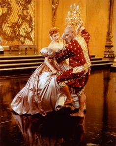 Mongkut-The King of Siam (Yul Bryner) is dancing with Anna Leonowens ( Deborah Kerr)