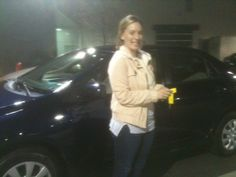 Ardmore Toyota congratulates Emily on her 2011 Toyota Corolla from Salesperson Reggie Wright.