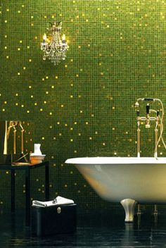 Magical designs from Bisazza.  This installation uses random gold glass mosaic tiles amongst luminous green Elena tiles evoking a starry night, snow flakes, confettii, pixie dust.   www.burgeandgunson.co.uk    #greenwithenvy #lifeinstyle