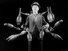 size: Photographic Print: Stroboscopic Image of Juggler Stan Cavenaugh Juggling Tenpins by Gjon Mili : Artists Gjon Mili, Circo Vintage, Just Good Friends, Hardcore, Circus Wedding, Art For Sale Online, Evil Clowns, Multiple Exposure, Big Top