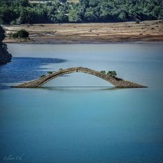 """""""° The old stone bridge of Manolis, was built in over the Agrafiotis river. Nowadays, after the construction of the artificial lake of Kremaston, you…"""" Old Stone, Bridges, Greece, Old Things, Construction, River, Island, World, Building"""