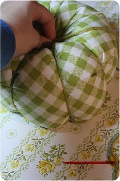 Tutorial on making fabric pumpkins ~ could use this pattern in a smaller size to…
