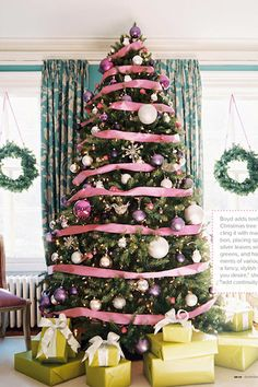Pink ribbon-wrapped tree. LOVE all the colors in this combo, gifts, ribbon, walls, window treatments. Lovely!