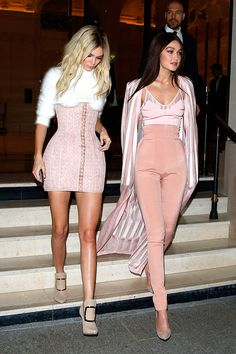 Not only did Gigi go brunette while Kendall went blonde, they also headed to the Balmain party after they walked the runway together. These two gals are unstoppable and they looked so fabulous in these sexy pink outfits.