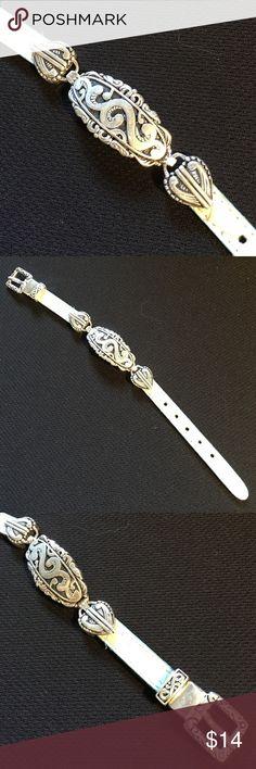 """Bracelet greenish gray / silver tone Bracelet greenish gray / silver tone approximately 8 1/2"""" long x 3/4"""" wide band is 3/8"""" wide. Never been worn. Jewelry Bracelets"""