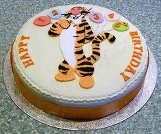 Tigger Cake. Round celebration birthday cake with Tigger cutout figure