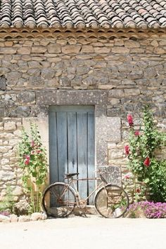 French farmhouse stone facade with weathered blue wood door, and vintage bicycle. French Farmhouse Decor Inspiration Ideas will take you on a romantic tour of images capturing this charming decor style. French Farmhouse Decor, French Country Cottage, French Countryside, French Country Style, French Country Decorating, Country Cottages, Farmhouse Interior, Farmhouse Door, Country Houses