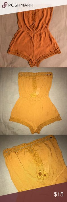 "Forever 21 Mustard Tube Top Jumpsuit Romper Forever 21 Mustard Tube Top Jumpsuit Romper  Size: S. This item is brand new, with tag, never worn, super cute, unique color. I'm 5'2"" small to medium female, I'd say this would fit someone petite or size XS just right! My little butt was coming out the bottom. This would also be perfect for a vacation trip over a bathing suit with some cute sandals. ☀️ This item is from a pet-free and smoke-free home. ✨ Forever 21 Dresses Strapless"
