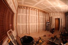 """Finished framing for the """"waveguide"""" wideband panel absorbers on rear wall. I'm sizing up the next phase - fourteen 10' foam-covered panels will be suspended from the joists."""