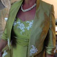 Would you have any lace added to your Mother of the Bride or Groom outfit?   This is a stunning effect here on one our outfits that Lesley made for our client.  We love the way it tones with her necklace and she also opted to have the same exquisite detailing added to her matching bag.  Sublime.  #motherofthebride #motherofthegroom #lesleycutlerbridal #wedding #handcrafted #Britishdesign #weddingaccessories #couture #madeinengland #gettingmarried #britishmade #weddinglook #makemydress… Groom Outfit, Prom Dresses, Wedding Dresses, Wedding Looks, Silk Dress, Mother Of The Bride, Wedding Accessories, Getting Married, Couture