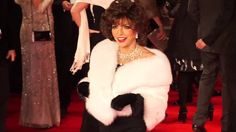 Monochrome maven:Furthering the veteran glamour-puss roster was ever-stunning 82-year-old Dame Joan Collins who wowed in her usual Hollywood style.