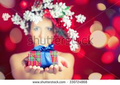 Christmas winter woman with tree hairstyle and makeup for holiday giving for you present or gift box! Magical lights star. Beauty fashion model. Red background. New Year or Halloween style