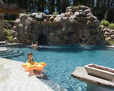 swim in grotto, Rock encased slide, fire feature surrounded by in pool seating. Pool also feature hidden stairs to second story tiki hut, and hidden spa. Luxury Swimming Pools, Luxury Pools, Swimming Pool Designs, Beach Entry Pool, Family Pool, Tropical Pool, Beautiful Pools, Beautiful Body, Mediterranean Design