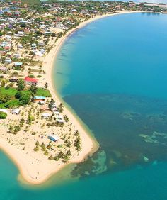 Aerial photo of Placencia Village in Belize.Our place was the 2 story red roof villa closest to the point.