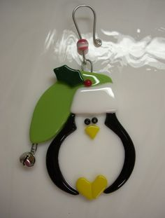 Fused Glass Penguin Ornament  Penguin Christmas Ornament Reserved For Justin. $15.00, via Etsy.  She also has snowmen and Santas.
