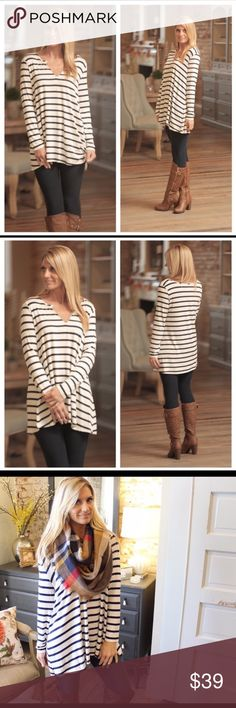 Beyond Basic striped tunic in cream and Navy Beyond Basic striped tunic in cream and Navy. Soft knit with long sleeves and a touch of suede at v-neck. Perfect paired with legging and boots or skinny jeans. 95% Rayon and 5% Spandex. Small (2/4), Medium (6/8), large (10/12) Infinity Raine Tops Tunics