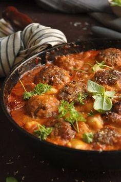 Gnocchi with creamy tomato sauce and meatballs