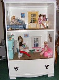 Turn an old dresser into a play house, keeping the bottom drawer for storage.