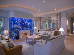 Amazing Aquarium Architecture - I just would do a bookcase or tv instead of a fireplace.