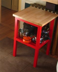 Make a kitchen island with IKEA lack tables: put two IKEA lack tables on top of each other and place a heavy maple butcher block on top. Genius.
