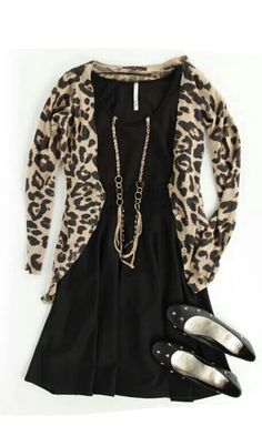 Casual black dress paired with animal print cardigan n studded flats and long gold jewlery to tie up the etire.