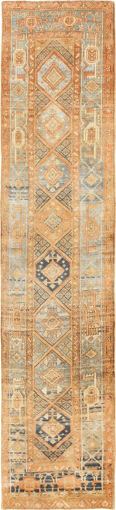 View this breathtakingly beautiful tribal design antique Persian Heriz Serapi runner rug #48994 from the Nazmiyal Collection in NYC.