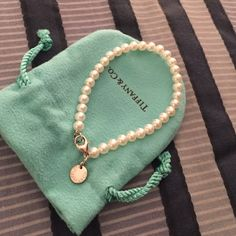 Tiffany pearl bracelet Worn a few times! Sat in jewelry bag and box when not worn!! Have original jewelry bag/box. Got as a gift beautiful on. Tiffany & Co. Jewelry Bracelets