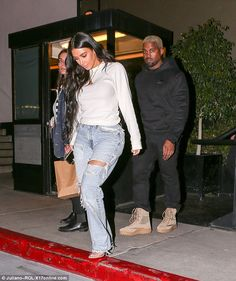 Feeding their spirits: Kim Kardashian was intent on reaping the benefits of southern comfort as she dined with Kanye West at a soul food jazz eatery in Los Angeles on Wednesday