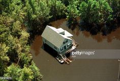 Flood water from Hurricane Floyd surrounds a home 17 September ...