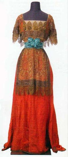 ornamentedbeing:    Callot Soeurs | Winter 1909.   Orange lamé with blue satin and metallic lace  Drexel University
