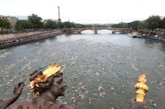 #Paris photo of the day: 4500 amateurs were swimming yesterday in Seine for #Triathlon. Not me!/via @MetroParis