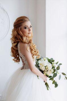 half down half up long curly wedding bridal hairstyle / http://www.deerpearlflowers.com/new-wedding-hairstyles-to-try/