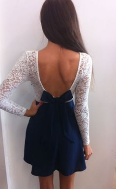 Open back dress in blue with sleeves