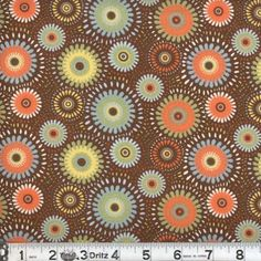 Lucky Medallion in Brown Cotton Quilt Fabric Fabric by fabric406