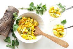 Fruit salad with mango, orange, kiwi and apple