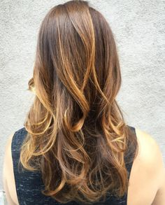 Hand-painted balayage highlights give hair dimension. Try a golden caramel on a brunette base like this one by stylist Stephanie Diaz Llewellyn. Aveda color formula in comments.