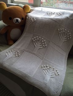 Free Knitting Pattern for Apple Tree Baby Blanket - This Martin Storey design features tree motifs in cable and bobbles. Charted only but a Raveler amgoth2000 has created a written translation of the chart. Pictured project by dreamychild