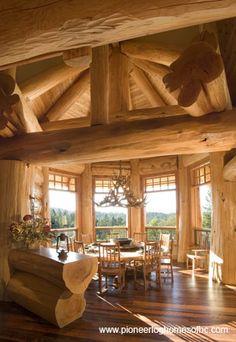 Log Homes - Interiors. I like the bar top flat log.