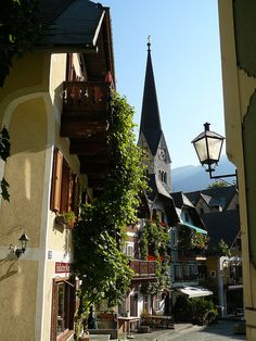 Picturesque streets of Hallstatt, Austria. I love Austria, such a beautiful country. // Ohhh, this picture reminds me of some of the ones I've taken. The atmosphere, the light, that particular wall type...