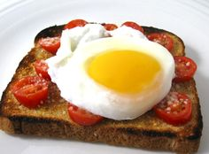 Poached Egg on Skinny Parmesan Tomato Garlic Toast. This NEW recipe makes an absolutely delicious way to start the day! It's completely vegetarian, simple to make and extremely satisfying. Each serving has 216 calories, 7 grams of fat and 5 Weight Watchers POINTS PLUS. http://www.skinnykitchen.com/recipes/poached-egg-on-skinny-parmesan-tomato-garlic-toast%E2%80%A8%E2%80%A8/